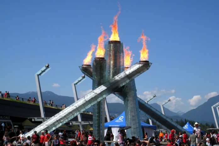 Flames are lit on the 2010 Olympics/Paralympics Cauldron on Canada Day, July 1, 2017. Jack Poole Plaza, Vancouver, British Columbia; Photo by ©Pacific Walkers