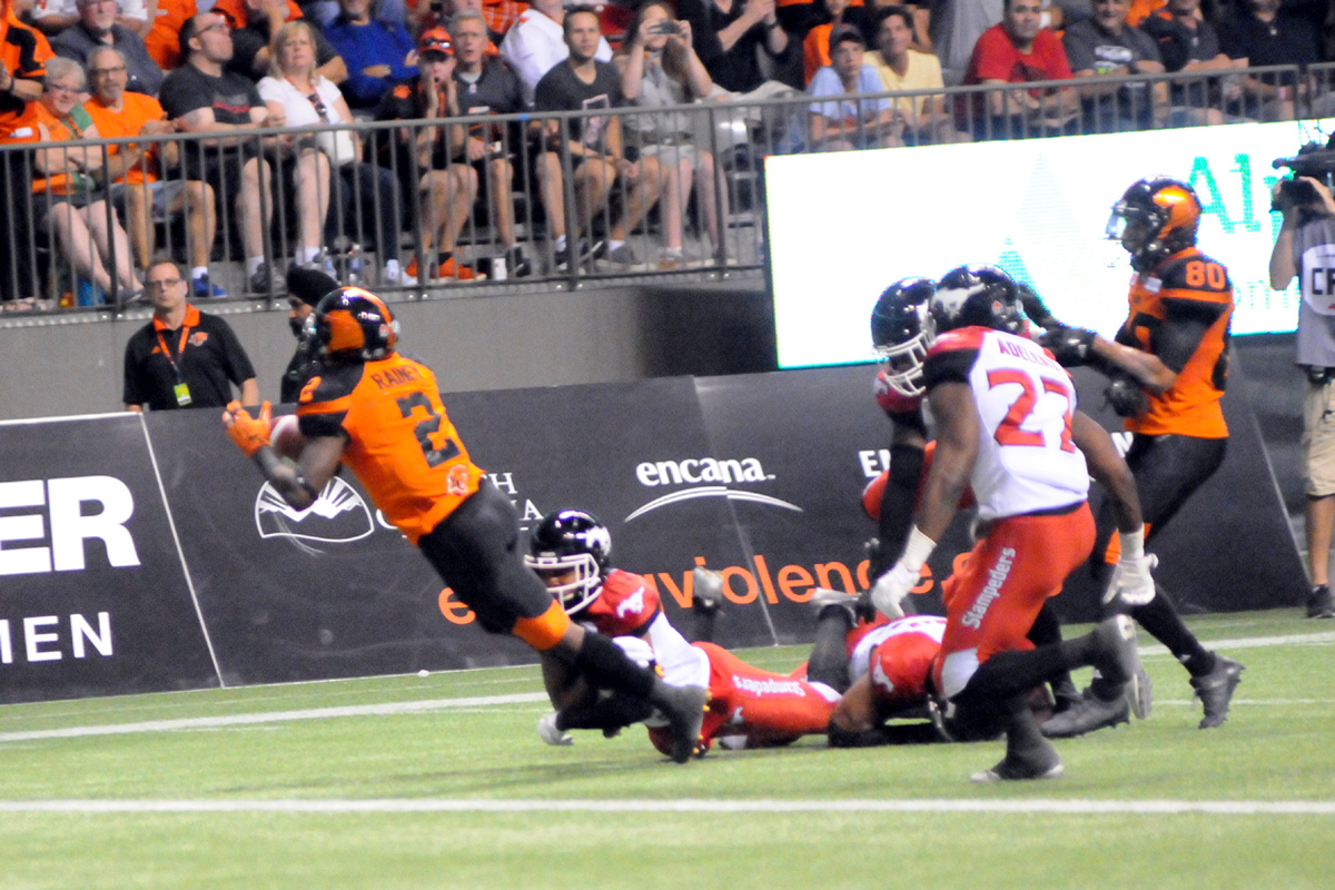 RB Rainey was caught by Stampeders defense. Aug 18, 2017. At BC Place, Vancouver, BC. Photo by ©Preston Yip