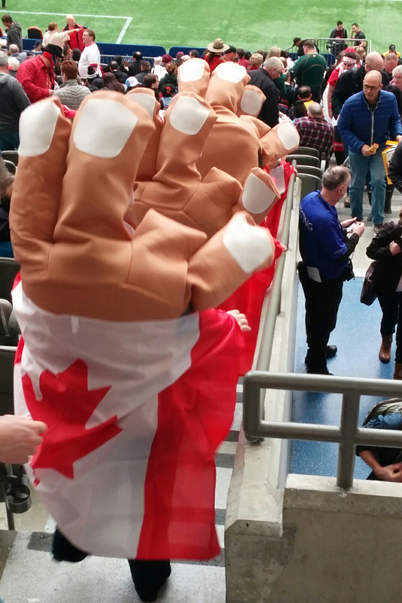 Rugby Sevens fans in some kind of hands costumes. March 12, 2016, BC Place