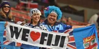 Enthusiastic Fiji Fans with Fiji colour wig and flags.