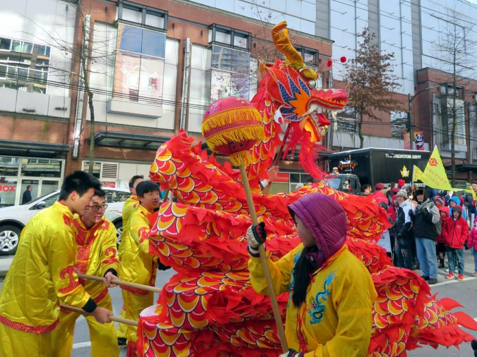 There is the dragon at the Chinese New Year Parade on Feb 18, 2018, in Chinatown, Vancouver; Photo by ©Pacific Walkers