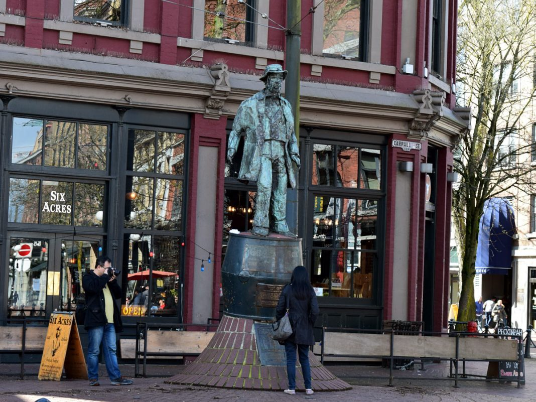 The origin of Vancouver, Gastown, Vancouver; Tour bus coming to Gastown, Vancouver, BC; Photo by ©Pacific Walkers