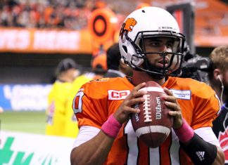 BC Lions QB Jennings is holding a CFL ball which is made by Wilson. Photo by ©Sam Maruyama